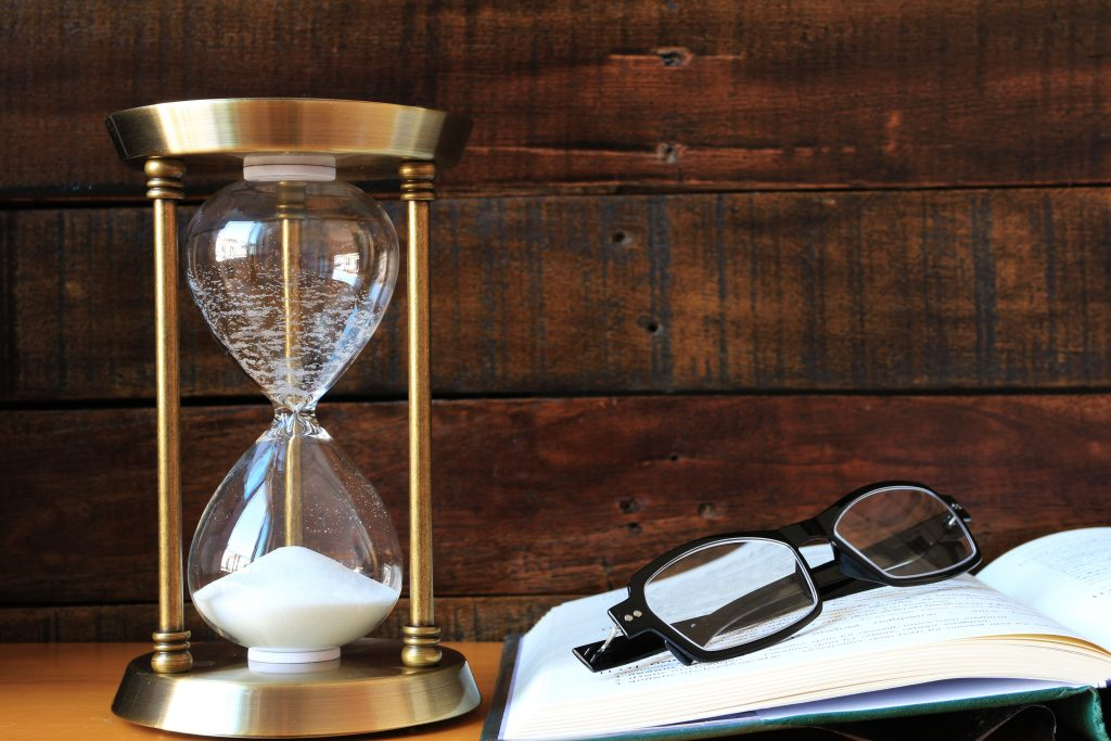 Sandglass with Book and Eyeglasses